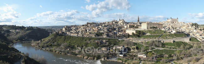 Panoramic shot of cityscape against cloudy sky, Toledo, Spain — Stock Photo