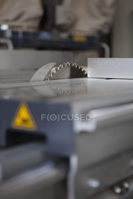 Surface level perspective of sliding table saw in workshop — Stock Photo