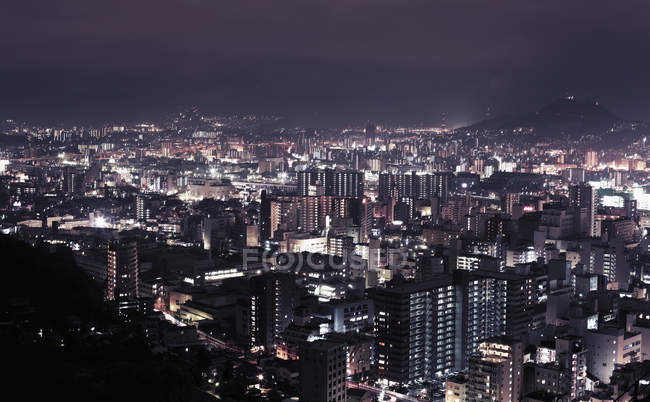 View of illuminated cityscape at night — Stock Photo