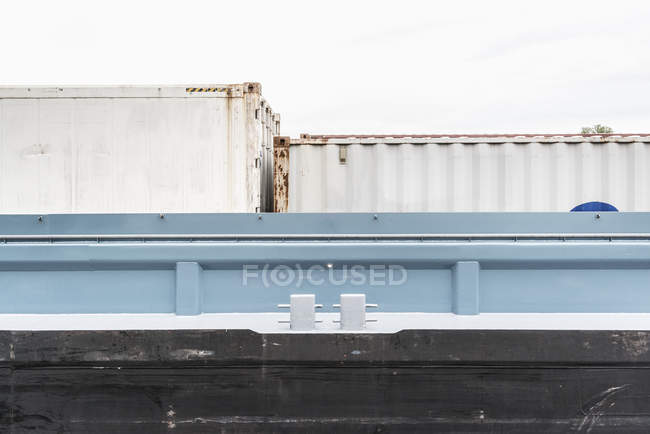 Low angle view of cargo containers at port — Stock Photo