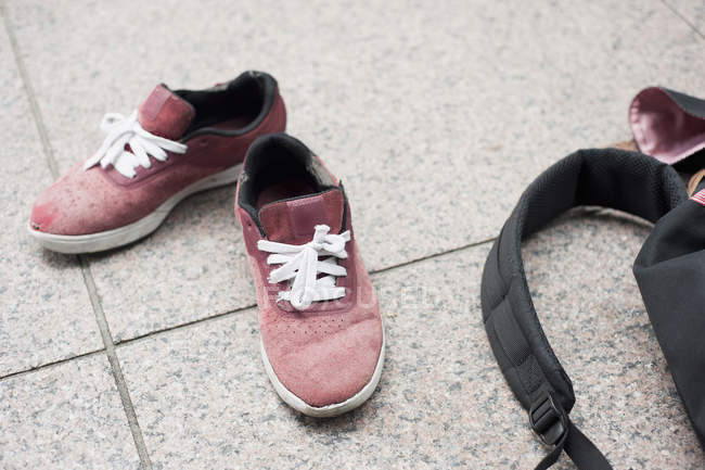 High angle view of shoes and bag on floor — Stock Photo