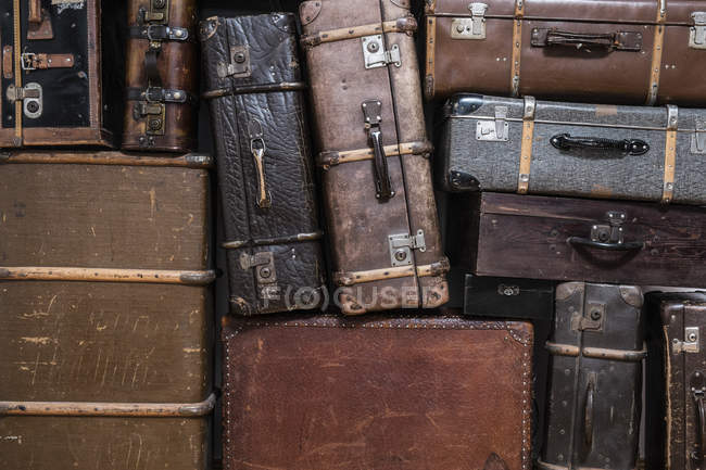Full frame shot of stacked old suitcases — Stock Photo