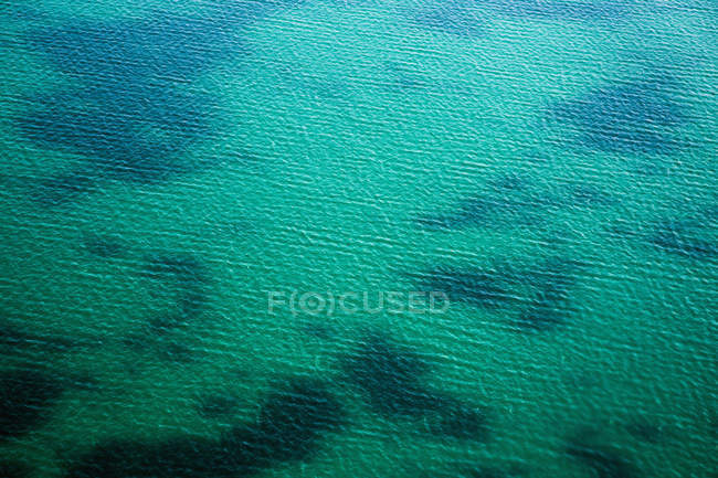 Aerial view of sea turquoise water and shallow bottom — Stockfoto
