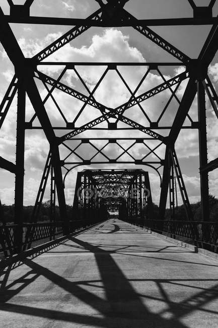Silhouette of bridge against cloudy sky — Stock Photo