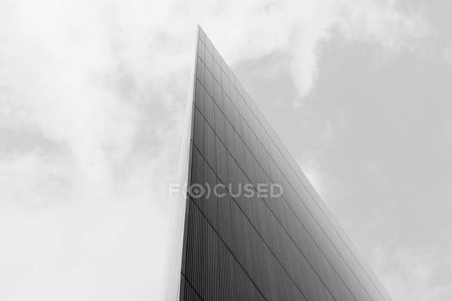Low angle view of glass building against sky — Stock Photo