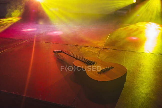 High angle view of acoustic guitar on illuminated stage — Stock Photo