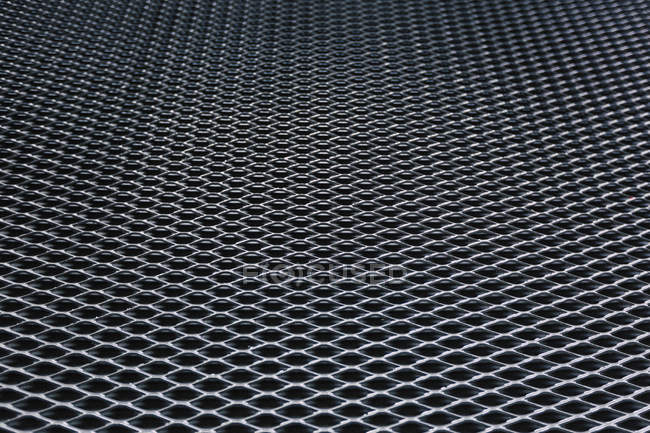 Close up view shot of steel metal grate pattern — Stock Photo
