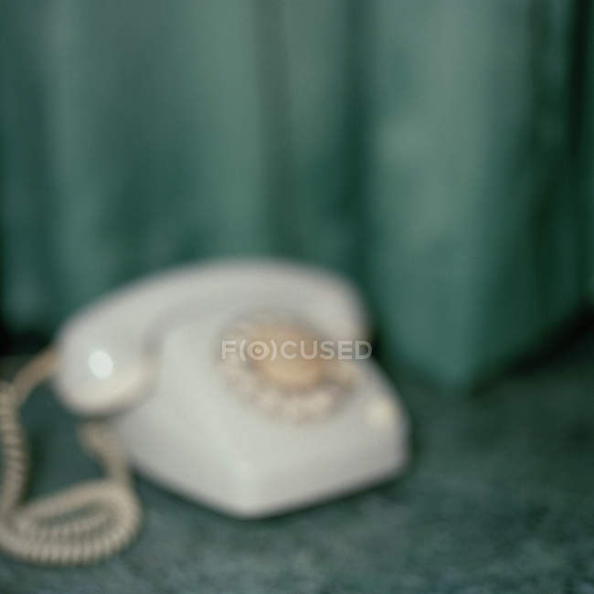 Defocused view of old fashioned telephone, — Stock Photo