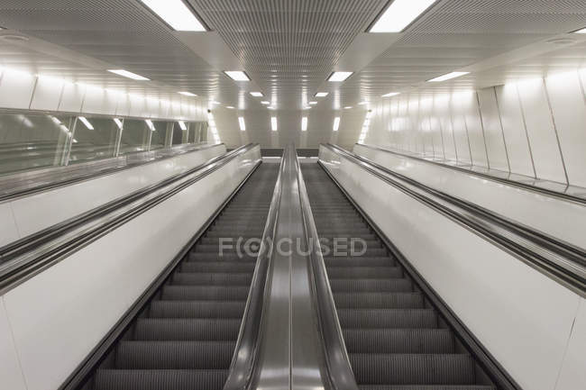 Low angle view of two empty escalators side by side — Stock Photo