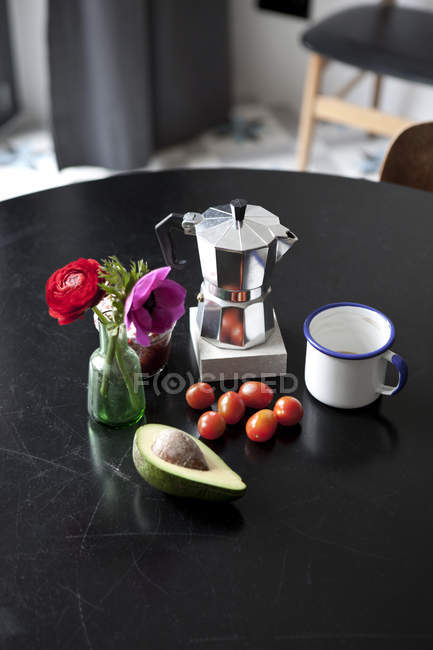 Table with espresso maker, coffee cup and ingredients for breakfast — Stock Photo