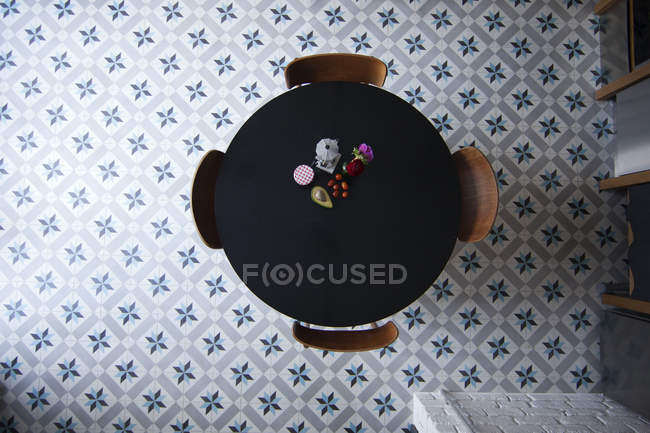 Directly above view of table with espresso maker, coffee cup and ingredients for breakfast — Stock Photo
