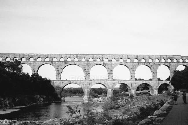 View of Pont du Gard over Gardon River against clear sky — Stock Photo