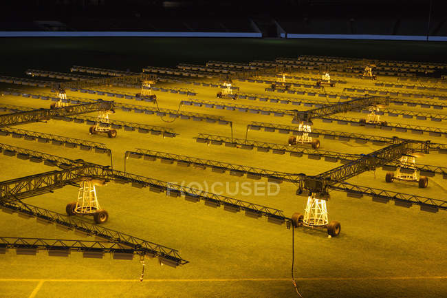 High angle view of artificial lights on soccer field — Stock Photo