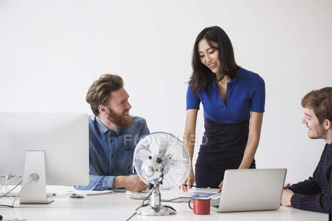 Business people communicating at desk in office — Stock Photo