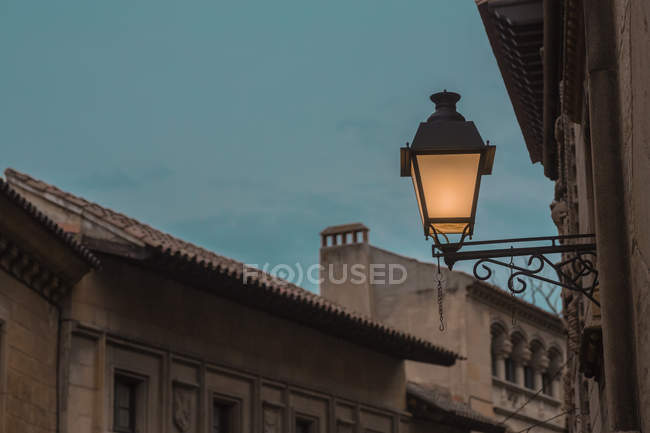 Low angle view of lit lantern on facade — Stock Photo