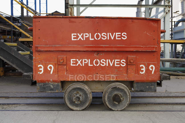 Container with explosives lettering at trunk on railroad tracks — Stock Photo