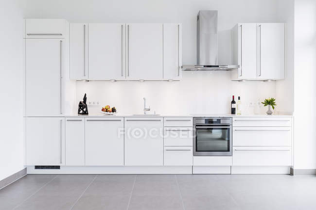 Modern kitchen design with white cabinets — Stock Photo