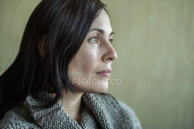 Pensive woman looking into distance — Stock Photo
