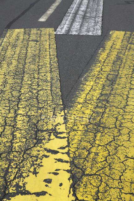 Detail of shabby markings on asphalt — Stock Photo
