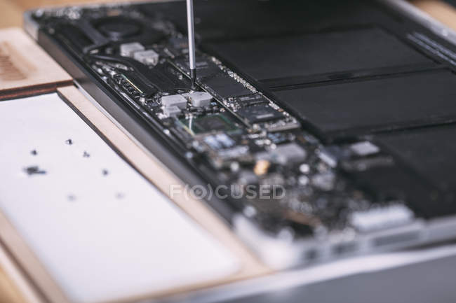 Close-up of digital tablet being repaired at electronics store — Stock Photo
