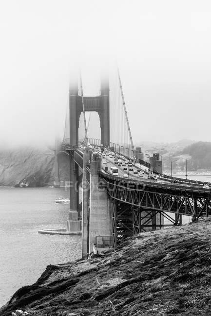 Scenic view of Golden Gate Bridge over bay on foggy day — Stock Photo