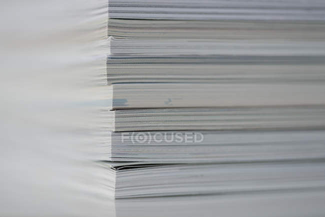 Close up view of stack of books on table — Stock Photo