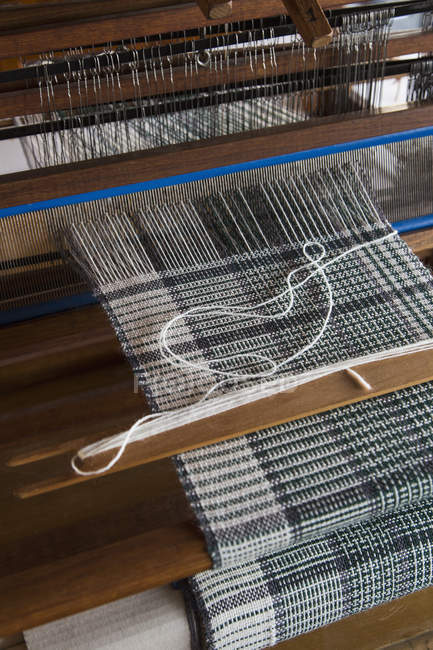 Close up view of working textile loom — Stock Photo