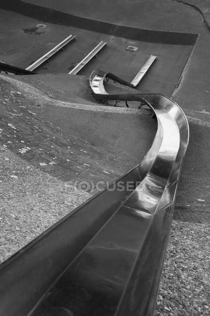 High angle view of long metal slide in park — Stock Photo