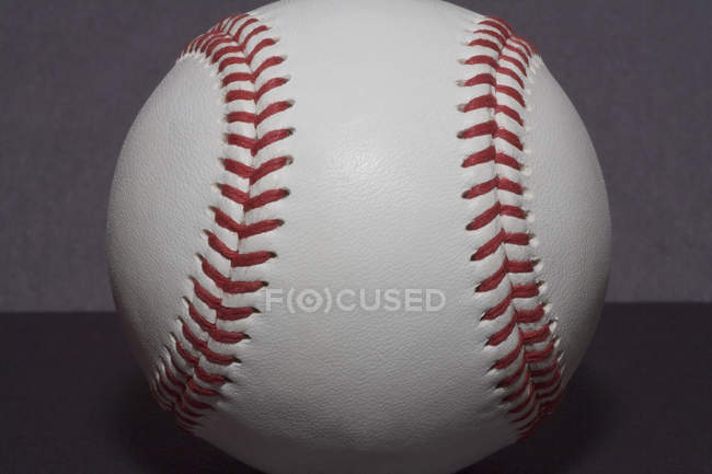 Close up view of with red stitching baseball — Stock Photo