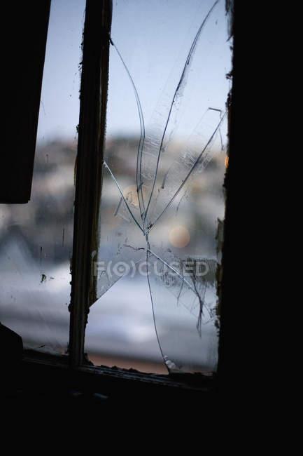 Close up view of broken window pane — Stock Photo