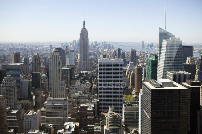 Aerial view of Manhattan skyscrapers on sunny day — Stock Photo