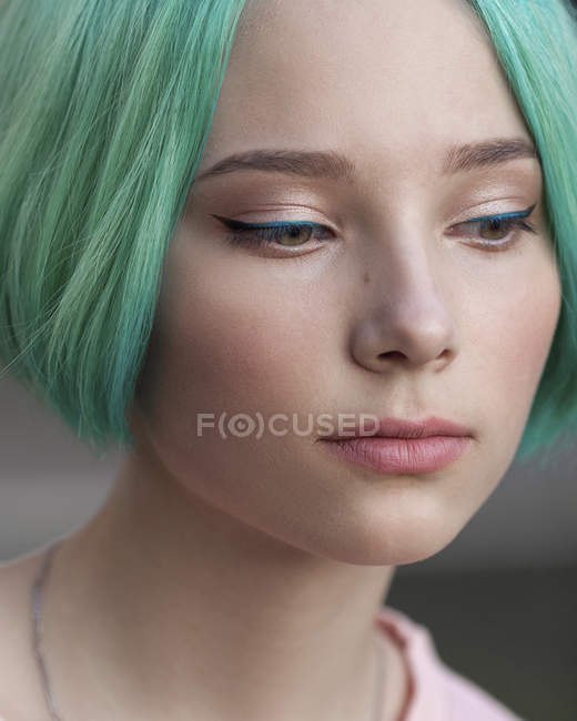 Close-up of thoughtful teenage girl with green dyed hair — Stock Photo