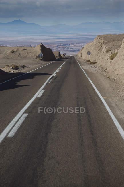 Empty highway running along arid Atacama Desert, Chile — Stock Photo