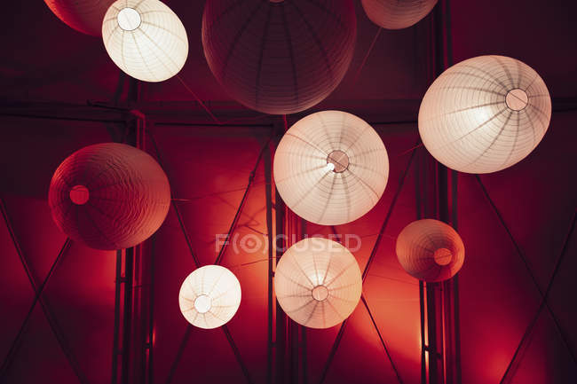 Bottom view of illuminated paper lights hanging from ceiling — Stock Photo