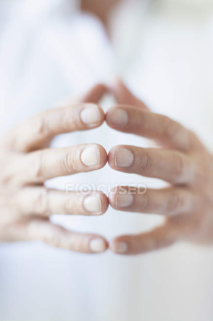 Crop male hands touching fingers — Stock Photo