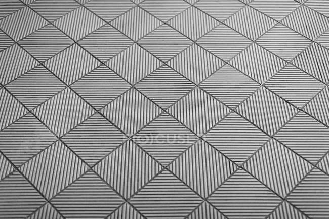 Full frame view of patterned floor tiles — стоковое фото