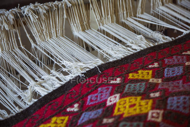 Close up view of fabric handloom weaving machine — Stock Photo