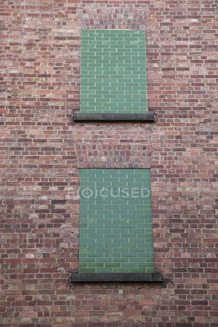 Exterior of brick wall with blocked windows — Stock Photo
