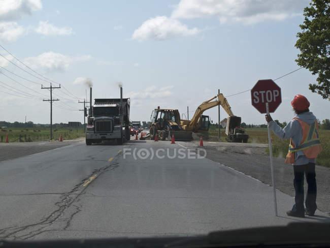 Road construction scene at sunny countryside — Stock Photo