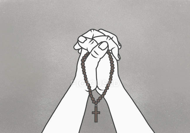 Cropped image of clasped hands holding rosary beads against gray background — Stock Photo