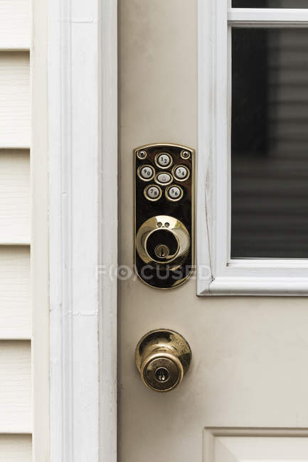 Close up view of shiny knobs and locks on closed door — Stock Photo