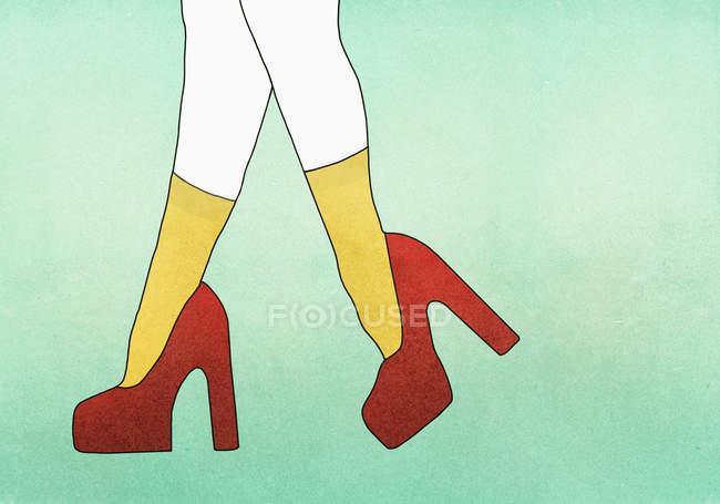 Low section of woman wearing red high heels — Stock Photo