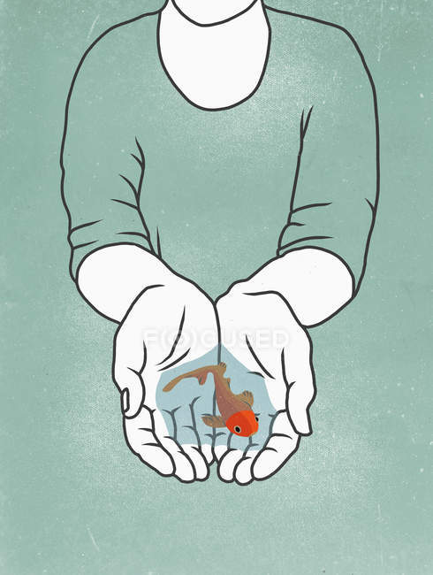 Midsection of person holding fish in cupped hands — Stock Photo