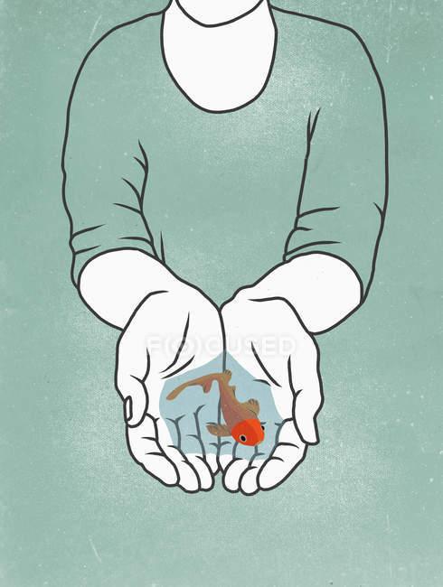 Міделю людина холдингу риби в жмені — стокове фото