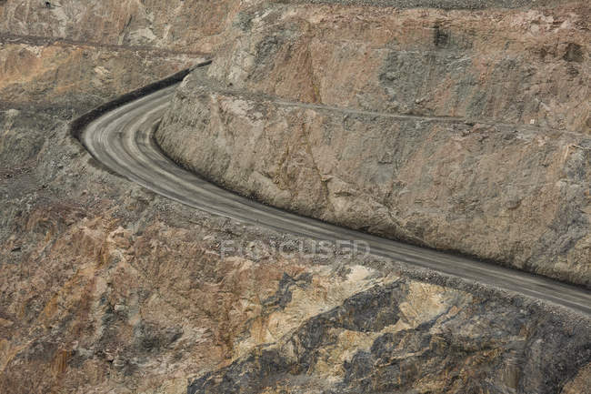 High angle view of empty dirt road at open-pit mine — Stock Photo