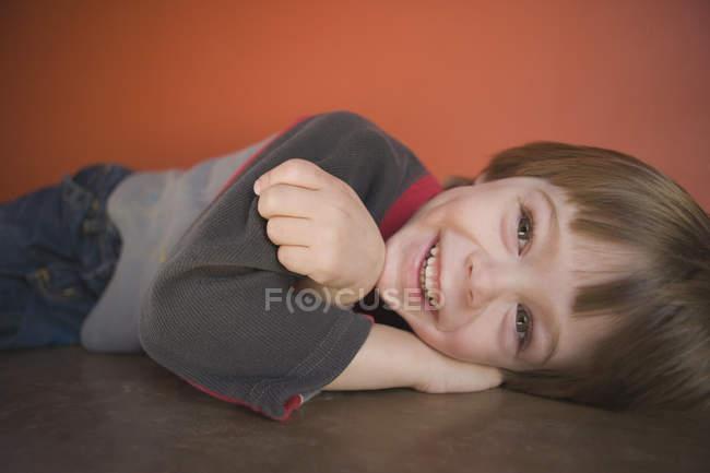 Young boy lying down — Stock Photo