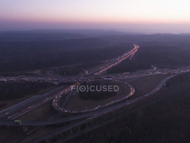 Aerial view of intersecting highways amidst landscape at sunset — Stock Photo