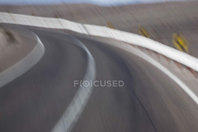 Blurred shot of curve in road — Stock Photo