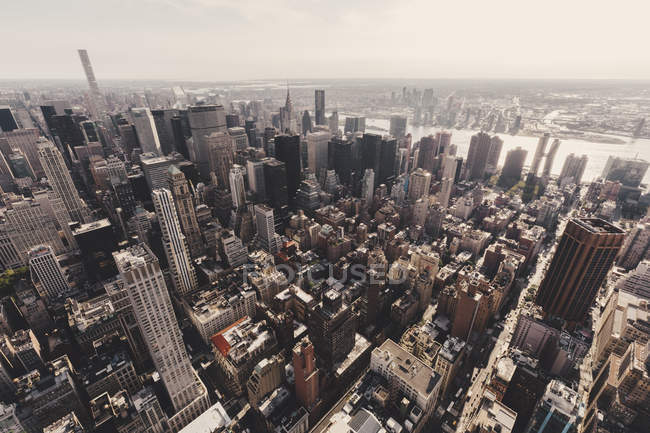 High angle view of skyscrapers and rofftops on sunny — Stock Photo