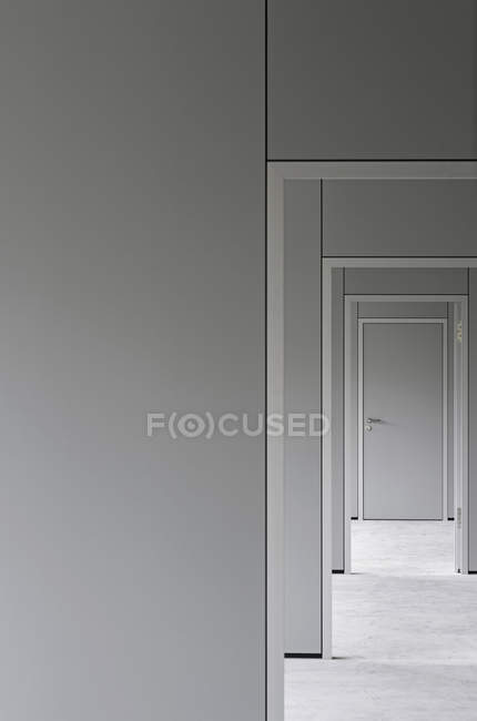 Empty corridor leading towards closed door in office — Stock Photo
